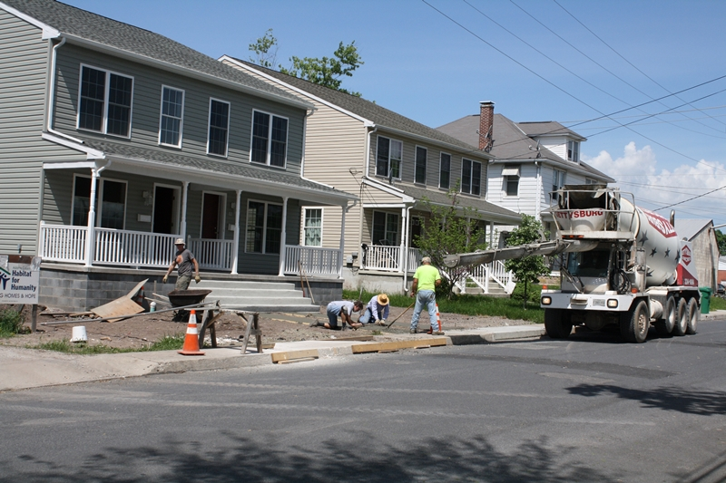 Sidewalks are being installed at Adams County Habitat for Humanity's newest duplex home, 82-84 Fifth Street, Gettysburg. The public is invited to an open house celebration on Sunday, June 1 from 1-3 pm.