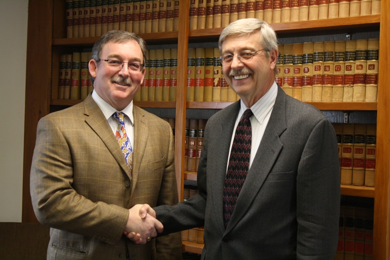 "April 2014 Milestone: Adams County Habitat for Humanity Board President C.L. ""Pete"" Ricker thanks Gettysburg attorney Gary Hartman for serving on the Board for more than 25 years in a volunteer capacity."