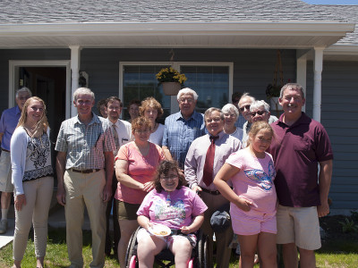 Group photo taken during the Adams County Habitat for Humanity Dedication and Open House on June 12, 2016.  From left to right:  Front row: Sarah Ricker, Bill Tyson, Jennifer Gross, Stacy Gross, Jim Martin (County Commissioner), Mia Ricker, Pete Ricker (SVP-ACNB Bank).  Middle row: Lynn Cairns, Dottie Cairns, John Phillips, May Phillips, Bill Leslie, and Judy Leslie.  Back row: Bill Scott, Carolyn Scott, Susan Tyson, Betty and Don Howard.