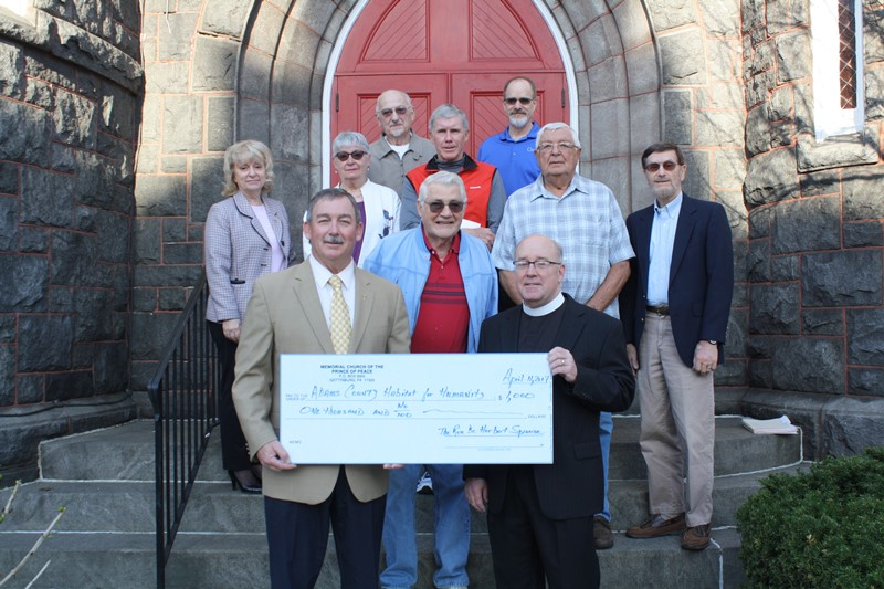 Prince of Peace Donates to Adams County Habitat for Humanity: Front: Pete Ricker, Bill Scott, and Father Herb Sprouse. Middle: Sue Pindle, Judy Leslie, Bill Tyson, John Phillips, Lynn Cairns. Back: Bill Leslie, Bob Boehner.