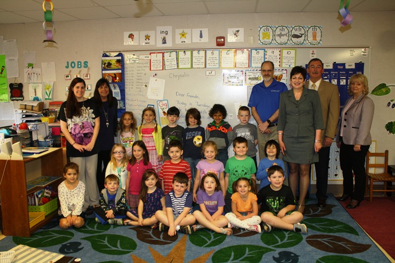 Kindergartners Help Adams County Habitat for Humanity Via Donation: The kindergarten class of Mrs. Brittney Lawrence, Gettysburg Montessori School, is photographed with: Left: Mrs. Lawrence and assistant teacher Ann Wright. Right: Adams County Habitat for Humanity Board Member Bob Boehner, school principal Faye Pleso, and board members Pete Ricker and Sue Pindle.